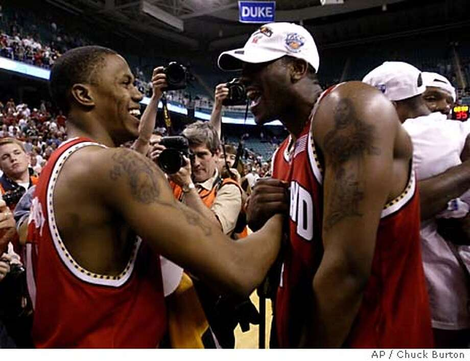 Maryland's John Gilchrist, left, and Travis Garrison celebrate after their overtime win over Duke, 95-87 in the ACC Basketball Tournament championship game, Sunday, March 14, 2004 at the Greensboro Coliseum in Greensboro, N.C. (AP Photo/Chuck Burton) Photo: CHUCK BURTON