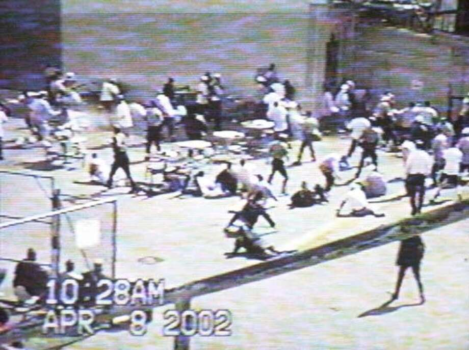 prisons_0123.JPG Photo taken on 1/20/04 in Sacramento.  Videotape of a riot at Folsom Prison is played at hearing.  The Senate Select Committee on Government Oversight and the California Correctional System holds a hearing on the state's troubled prison system and wether it can be trusted to police it self. This comes after a court-appointed monitor found the former chief of prison and a top deputy should be held in contempt for thwarting an investigation into prison guard misconduct and then lied to federal investigators who were looking into the matter. CHRONICLE PHOTO BY MARK COSTANTINI MANDATORY CREDIT FOR PHOTOG AND SF CHRONICLE/ -MAGS OUT Photo: MARK COSTANTINI