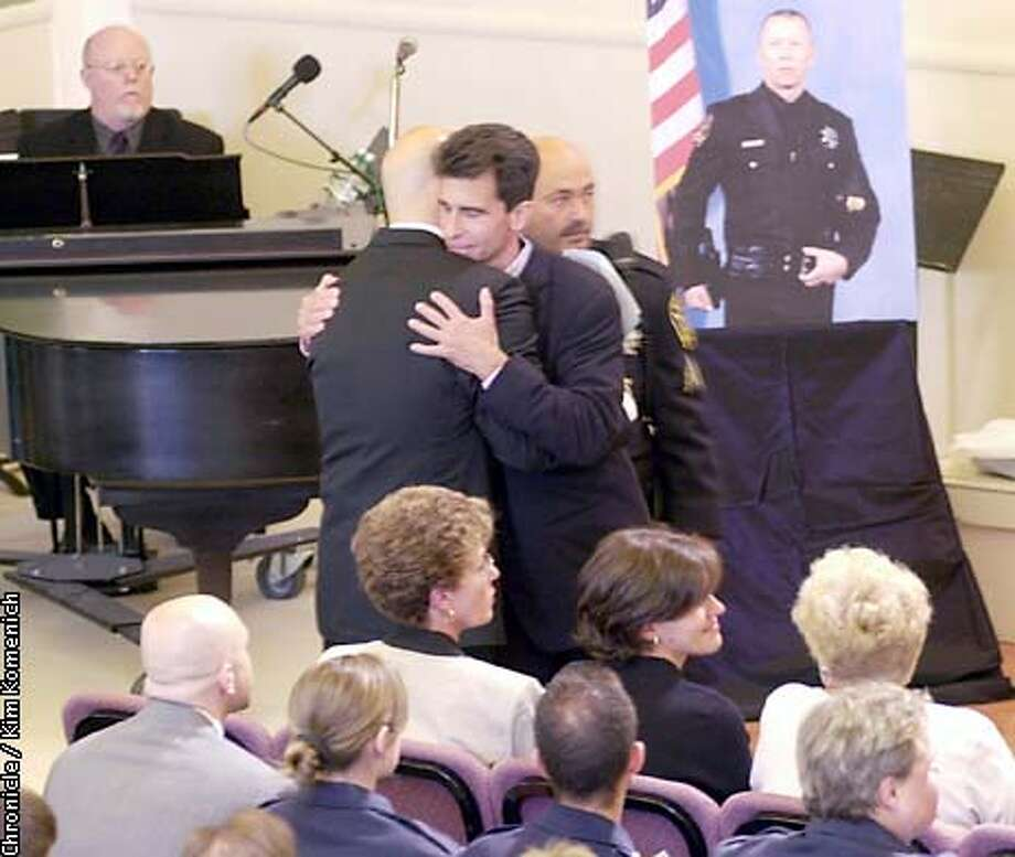 Memorial for SFPD John Cook at Metopolitan Community Church. Supervisor Mark Leno hugs Jared (last name TK), the partner (as in the couple, not the squad car) CHRONICLE PHOTO BY KIM KOMENICH Photo: KIM KOMENICH