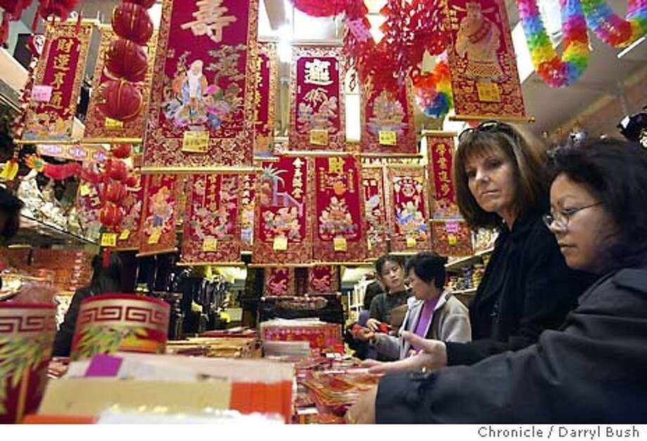 Gail Landers of Greenbrae, back right, and Angie Chan of Fremont, far right (near) shop for Chinese New Year decorations to put in their office at Wells Fargo Trade Bank as the shop at King Exquisite shop on Jackson in Chinatown. 1/21/04 in San Francisco. DARRYL BUSH / The Chronicle Photo: DARRYL BUSH