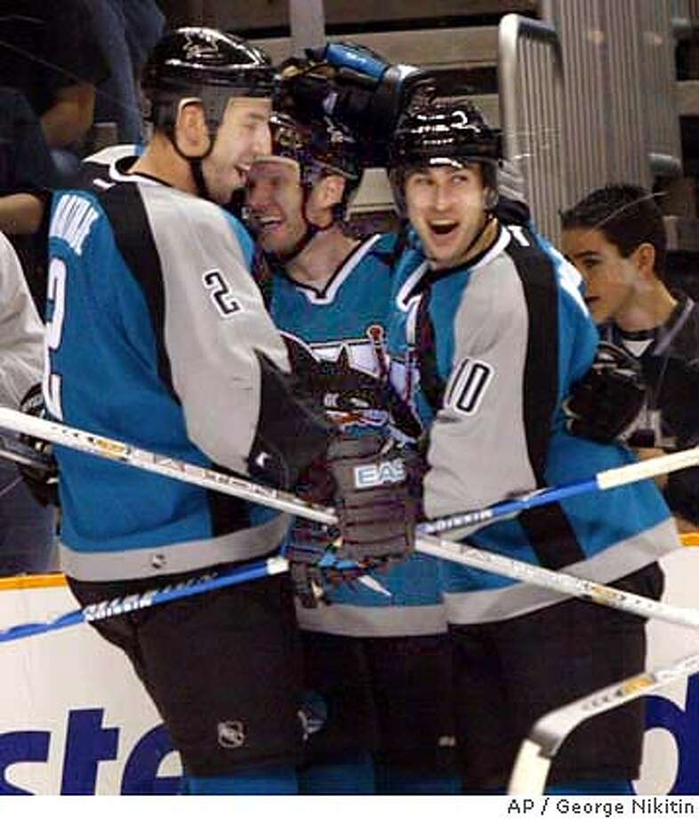 San Jose Sharks Alyn McCauley, right, celebrates with teammates Mike Rathje, left, and Nils Ekman, after scoring a second-period goal against the Los Angeles Kings, Saturday, March 13, 2004, at HP Pavilion in San Jose, Calif. (AP Photo/George Nikitin) Photo: GEORGE NIKITIN