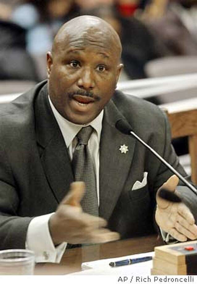 Roderick Hickman, head of the California Youth and Adult Correctional Agency, answers questions while appearing for a second day before a Senate committee hearing at the Capitol in Sacramento, Calif., Wednesday, Jan. 21, 2004. Hickman told members of the Senate Select Committee on Government Oversight and the California Correction Systems that he is forming a plan to reform California's troubled prison system.(AP Photo/Rich Pedroncelli) Photo: RICH PEDRONCELLI