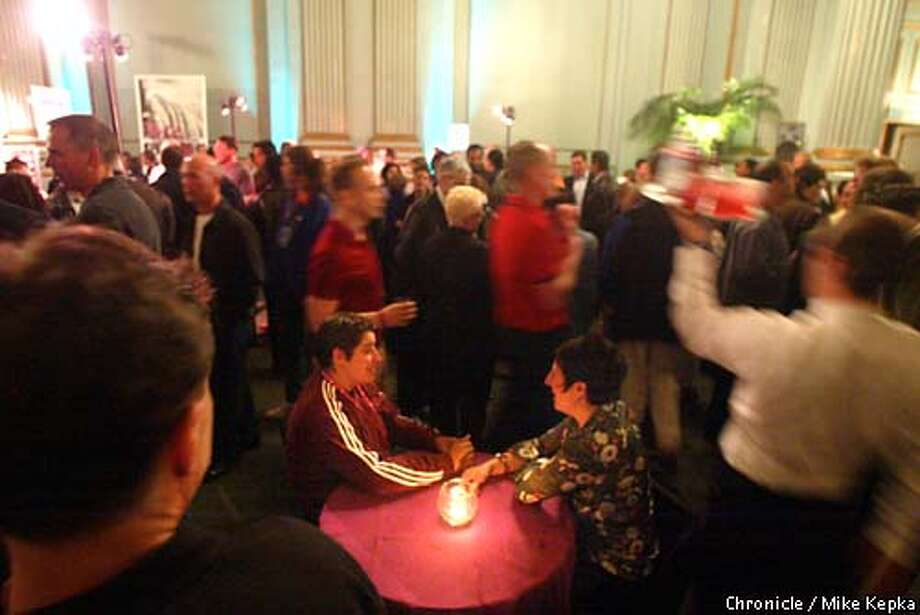 Jill Shenker and Mazzy Thompson managed to find a quiet among the reveler at the opening night party for the Lesbian and Gay Film Festival at the Herbst Theater in San Francisco Thursday night. BY MIKE KEPKA/THE CHRONICLE (deadling photo not color corrected) Photo: MIKE KEPKA