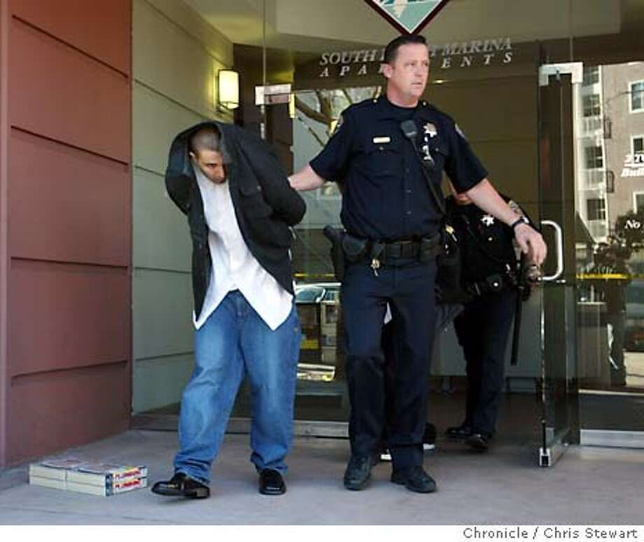 hostage0054_cs.jpg Event on 1/21/04 in San Francisco.  An unidentified person is walked away in handcuffs from a possible hostage situation at the South Beach Marina Apartments, 2 Townsend Street at the Embarcadero. Chris Stewart / The Chronicle An unidentified man is taken away from South Beach Marina Apartments after a standoff with police. Photo: Chris Stewart