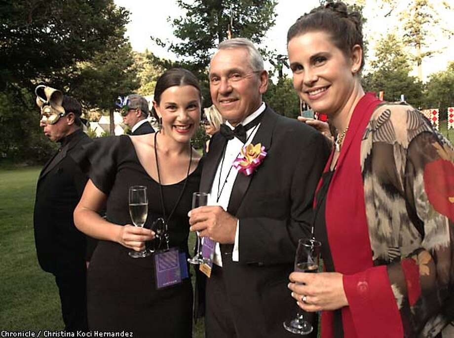Family affair: Napa Valley Wine Auction co-chairs Andrea Pecota White, left, and sister Kara Pecota Dunn with their father, Robert. Chronicle photo by Christina Koci Hernandez