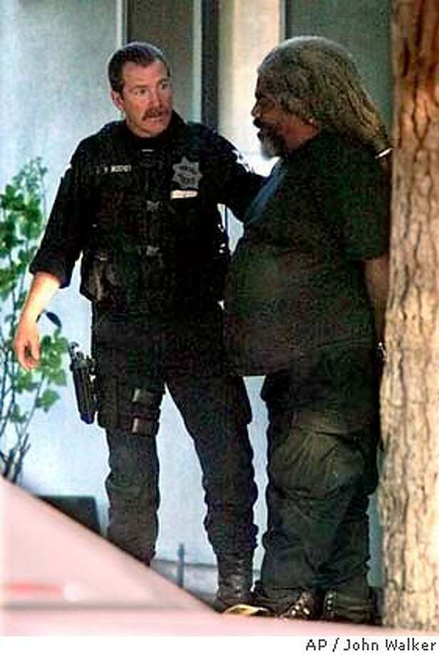 Suspect Marcus Wesson is led away in handcuffs by Fresno Police officers after giving himself up following a standoff where three women, three toddlers and an infant were found dead Friday afternoon, March 12, 2004, in a home in Fresno, Calif. The bodies were discovered after police responded to a call about a custody dispute on the city's west side, police Chief Jerry Dyer said. Police arrested Wesson, 57, who walked out of the house and surrendered when a SWAT team arrived. The bodies were discoveredshortly after Wesson was taken into custody. (AP Photo/Fresno Bee, John Walker) Suspect Marcus Wesson is led away in handcuffs by Fresno police officers after giving himself up. Suspect Marcus Wesson is led away in handcuffs by Fresno police officers after giving himself up. Photo: JOHN WALKER