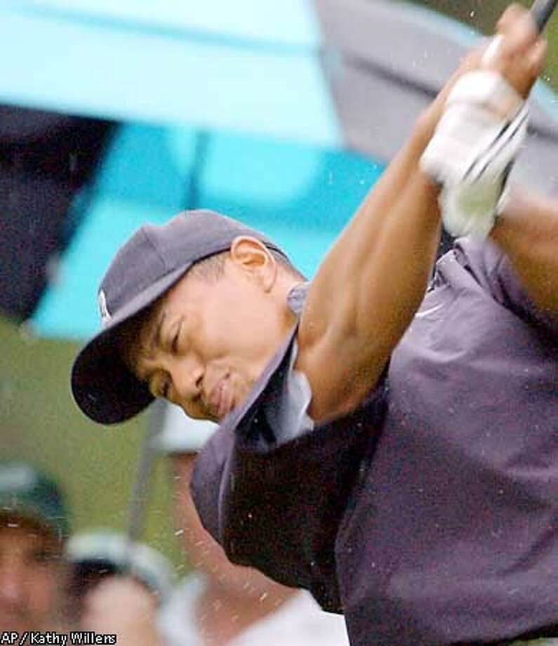 Tigers Woods is a perfect 4-0 when leading at the halfway point in major championships. Associated Pres photo by Kathy Willens