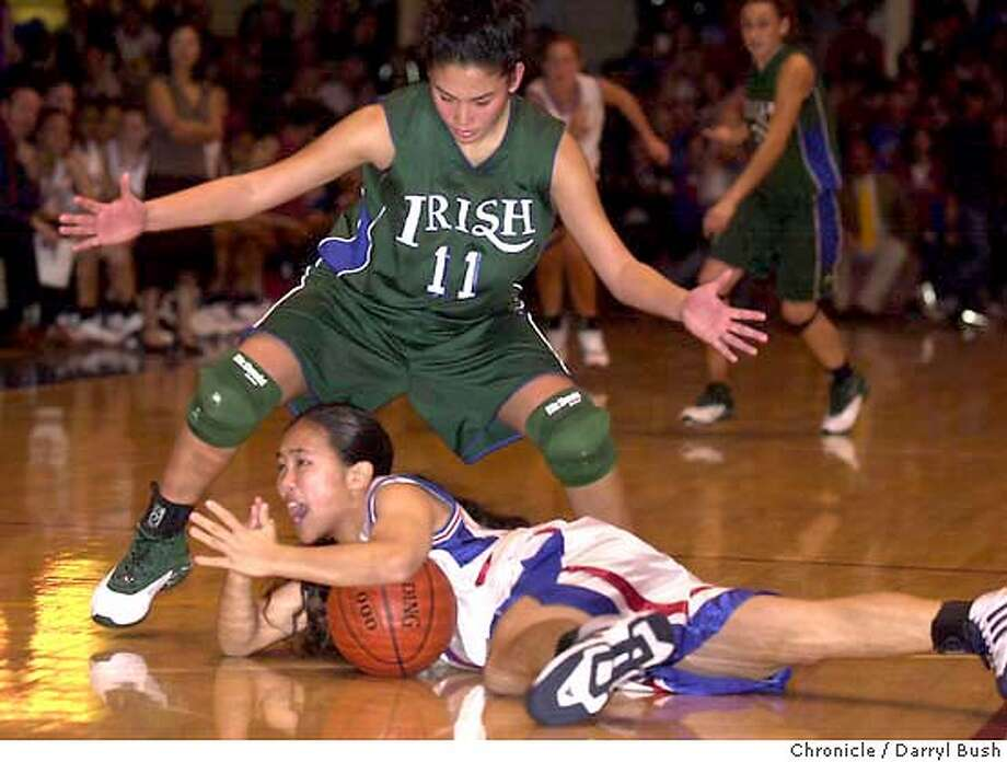 Sacred Heart Cathedral Trisha Alaba goes after St. Ignatius Stephanie Chan who tries to call time out in the 4th qtr of women's varsity at Kezar Pavillion. 1/13/04 in San Francisco. DARRYL BUSH / The Chronicle Photo: DARRYL BUSH