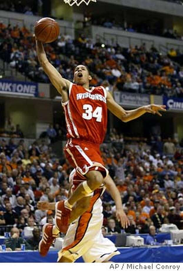 Wisconsin's Devin Harris goes up for a dunk in the second half against Illinois in the second half of championship game of the Big Ten Tournament in Indianapolis, Sunday, March 14, 2004. Harris scored 29 and was named tournament MVP. Wisconsin defeated Illinois 70-53. (AP Photo/Michael Conroy) Wisconsin point guard Devin Harris, the Big Ten tournament MVP, will be key to the Badgers' success in the NCAAs. Photo: MICHAEL CONROY