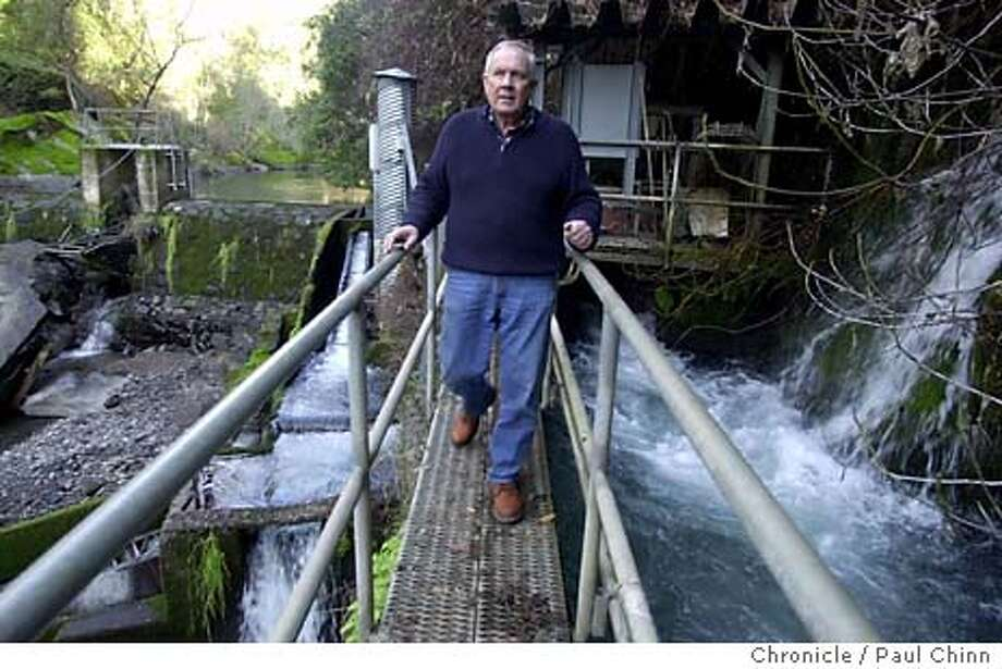 creek_087_pc.JPG Bill Kier walks across a catwalk after looking at the dam. The Eagle Canyon diversion dam on the North Fork Battle Creek in Manton on 1/22/04. PAUL CHINN / The Chronicle Photo: PAUL CHINN