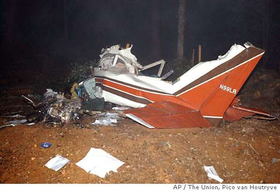 The Union photo/Pico van Houtryve  Wreckage of a Cessna airplane is scattered on private property off Greenhorn Road in Nevada County Monday night, January 19, 2004. Two people, believed to be from the Bay Area, died in the crash.