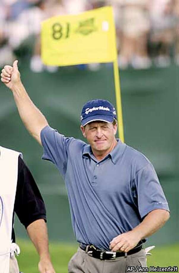 Fred Funk gives the gallery thumbs up after he made par at the 18th hole during the second round of the at Hazeltine National Golf Club in Chaska Minn., on Friday, Aug. 16, 2002. Funk started his round on the 10th hole. (AP Photo/Ann Heisenfelt) Photo: ANN HEISENFELT