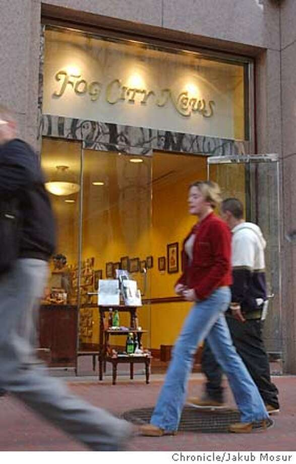 People walk in front of Fog City News, owned by Adam Smith, sells newspapers, magazines, and imported chocolate in the financial district in San Francisco on Thursday, Jan. 8, 2004. Event on 1/8/04 in San Francisco. JAKUB MOSUR / The Chronicle Photo: JAKUB MOSUR