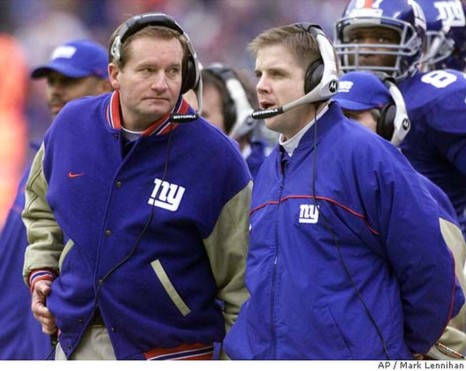 New York Giants head coach Jim Fassel, left, and Offensive Coordinator/Quarterbacks Sean Payton are shown along the sideline during the NFC Championship game Sunday January 14, 2001 at Giants Stadium in East Rutherford, N.J. The Giants meet the Baltimore Ravens in Super Bowl XXXV Sunday Jan. 28, 2001 in Tampa, Fla. (AP Photo/Mark Lennihan) Photo: MARK LENNIHAN