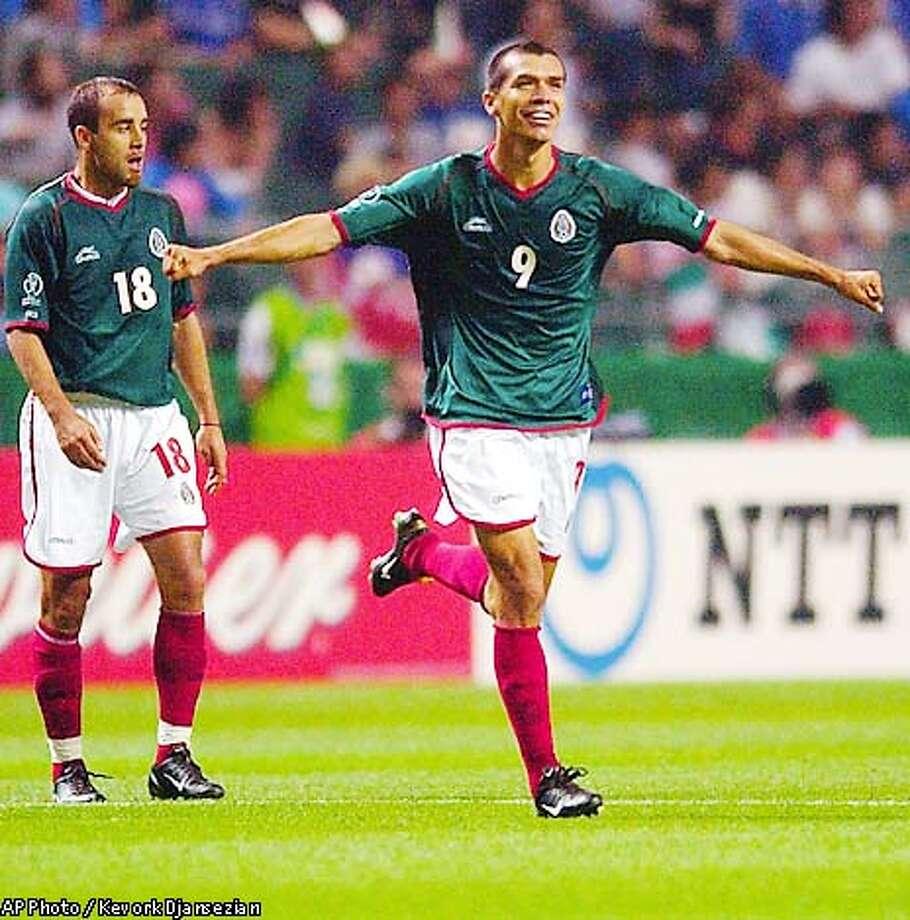 Mexico's forward Jared Borgetti, right, celebrates his goal against Italy in their 2002 World Cup match in Oita, Japan Thursday, June 13, 2002. At left is teammate Joahan Rodriguez. The teams played to a 1-1 tie. (AP Photo/Kevork Djansezian) Photo: KEVORK DJANSEZIAN