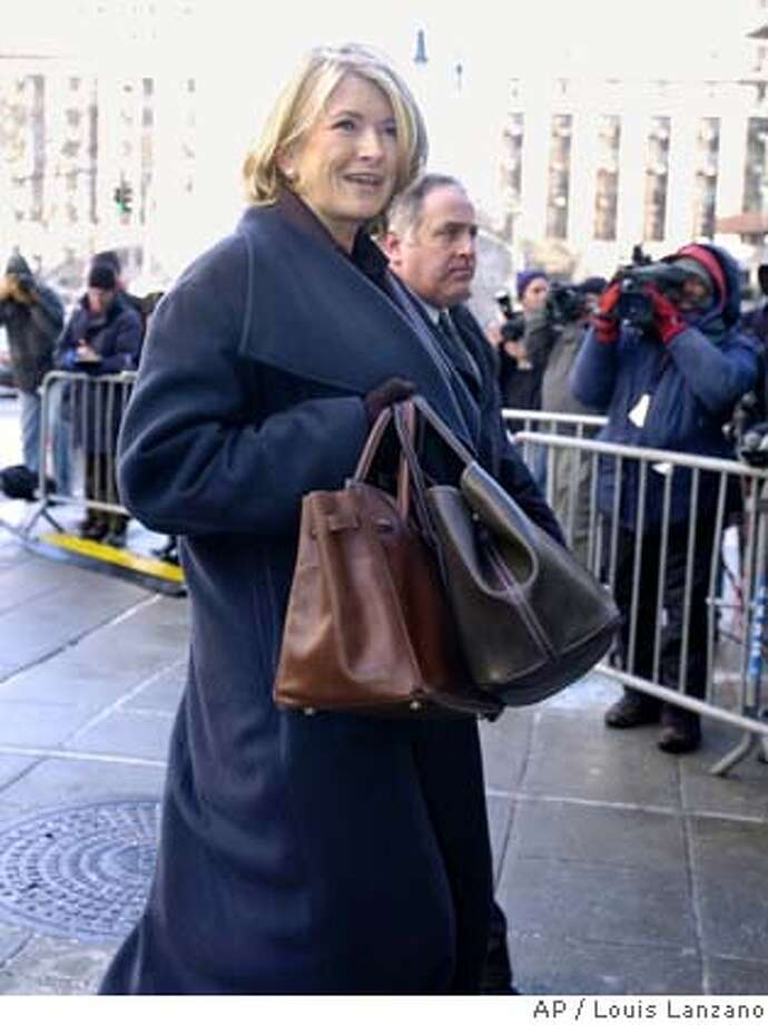 arrives at a New York federal courthouse Tuesday Jan. 20, 2004 for her first appearance at her closely watched trial. The trial, which could determine whether the style guru does time in prison, is to begin in earnest as lawyers start narrowing down a jury pool to the 12 that will choose Stewart's fate. (AP Photo/Louis Lanzano) Photo: LOUIS LANZANO