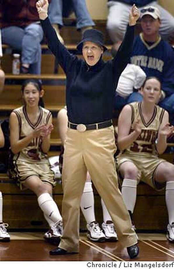 Event at Milpitas on 1/14/04. Mills High School girls basketball coach Kelly Shea-gallo, who has breast cancer, continues to coach her very successful team in the midst of her treatment. Here she is cheering on her girls team against Hillsdale High School. Games was at Mills HS.  Liz Mangelsdorf/ The Chronicle MANDATORY CREDIT FOR PHOTOG AND SF CHRONICLE/ -MAGS OUT Photo: LIZ MANGELSDORF