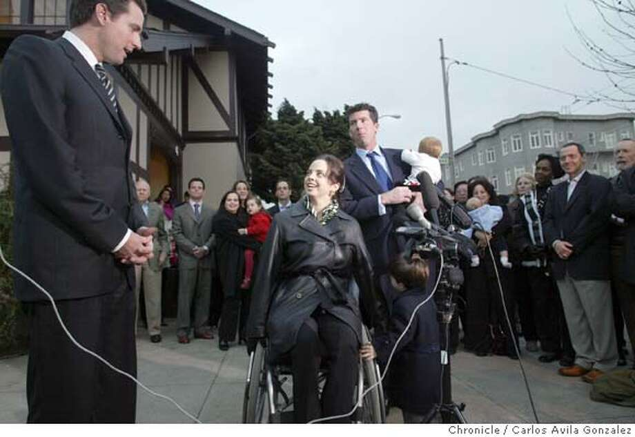 San Francisco Mayor, Gavin Newsom, left, announced Monday, January 19, 2004, that Michaela Alioto-Pier, center was appointed to fill his empty supervisor's seat at Moscone Playground in San Francisco, Ca. Alioto-Pier was joined at the microphone by her husband, Tom Pier, holding daughter, Giovanna, 9 mos, and son, Nicholas, 2. Photo taken 01/19/04, in San Francisco, Ca.  Photo by Carlos Avila Gonzalez/The San Francisco Chronicle Photo: Carlos Avila Gonzalez