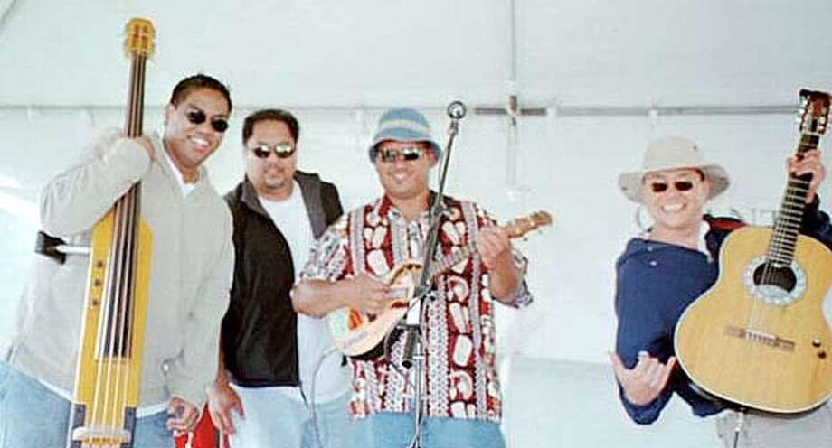 Performers with Ka Ehu Kai � (left to right) Ray Bambao Jr., Ray Bambao Sr., Tennyson Lum and Aldon Sanders � seen at the Aloha Festival in San Francisco in 2000.