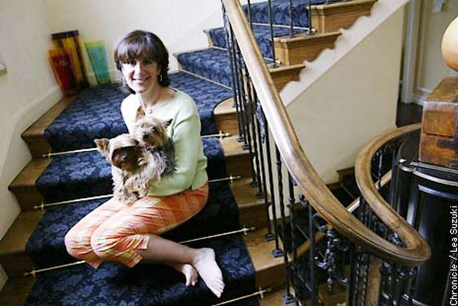 Emily Scott Pottruck with her dogs, Boomer and Andy at her home in San Francisco. A look the investing strategy of Emily Scott Pottruck, a former Wall Street professional who is now married to David Pottruck, ceo of Charles Schwab Corp.  PHOTO BY LEA SUZUKI/SAN FRANCISCO CHRONICLE Photo: LEA SUZUKI