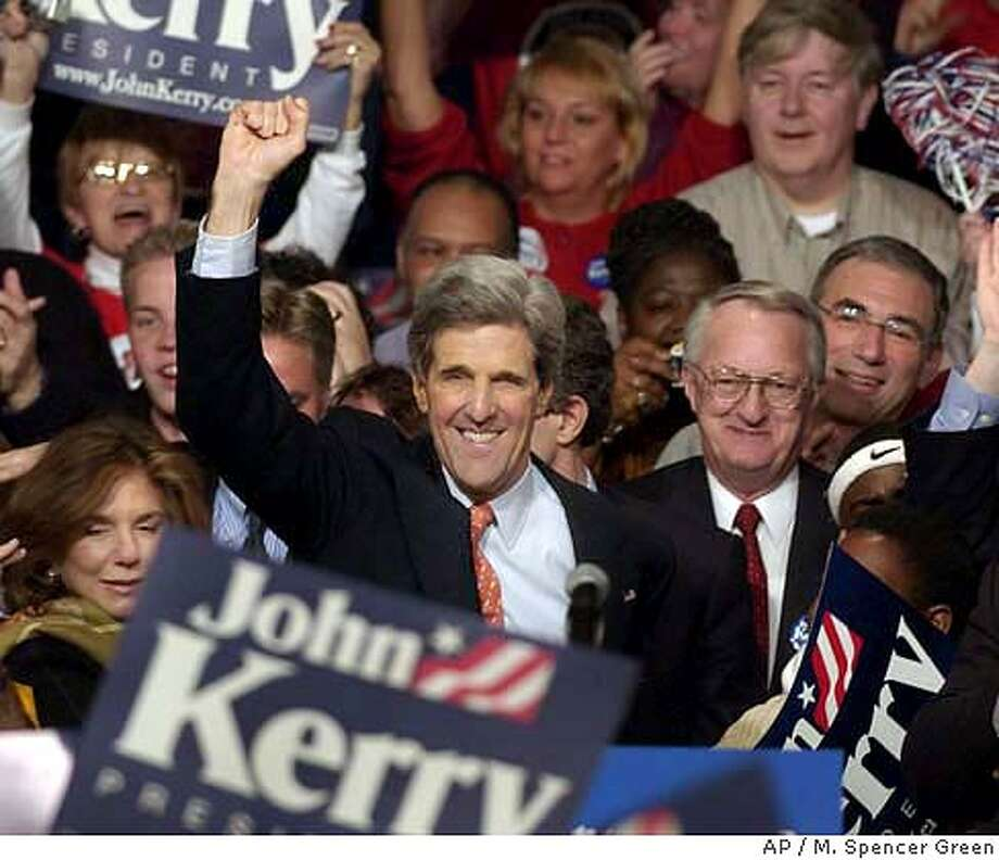 Presidential hopeful Sen. John Kerry acknowledges the crowd at a victory party Monday, Jan. 19, 2004 in Des Moines, Iowa after Kerry was declared the winner of the Iowa Caucus. (AP Photo/M. Spencer Green) Photo: M. SPENCER GREEN