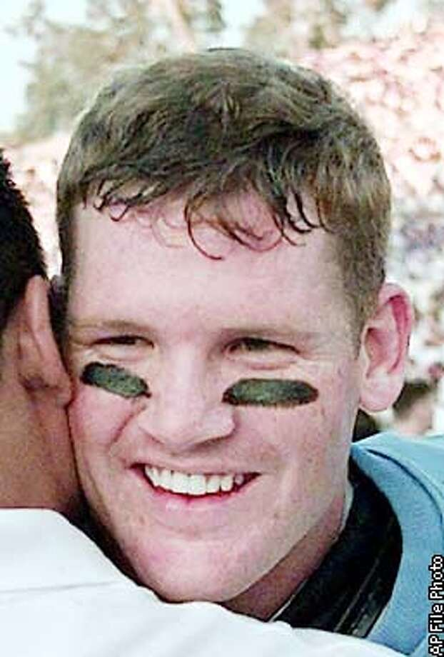 UCLA's quarterback Cade McNown gets a hug from a friend after defeating cross-town rival USC 34-17 at the Rose Bowl in Pasadena, Calif., Saturday, Nov. 21, 1998. (AP Photo/Michael Caulfield) Photo: MICHAEL CAULFIELD