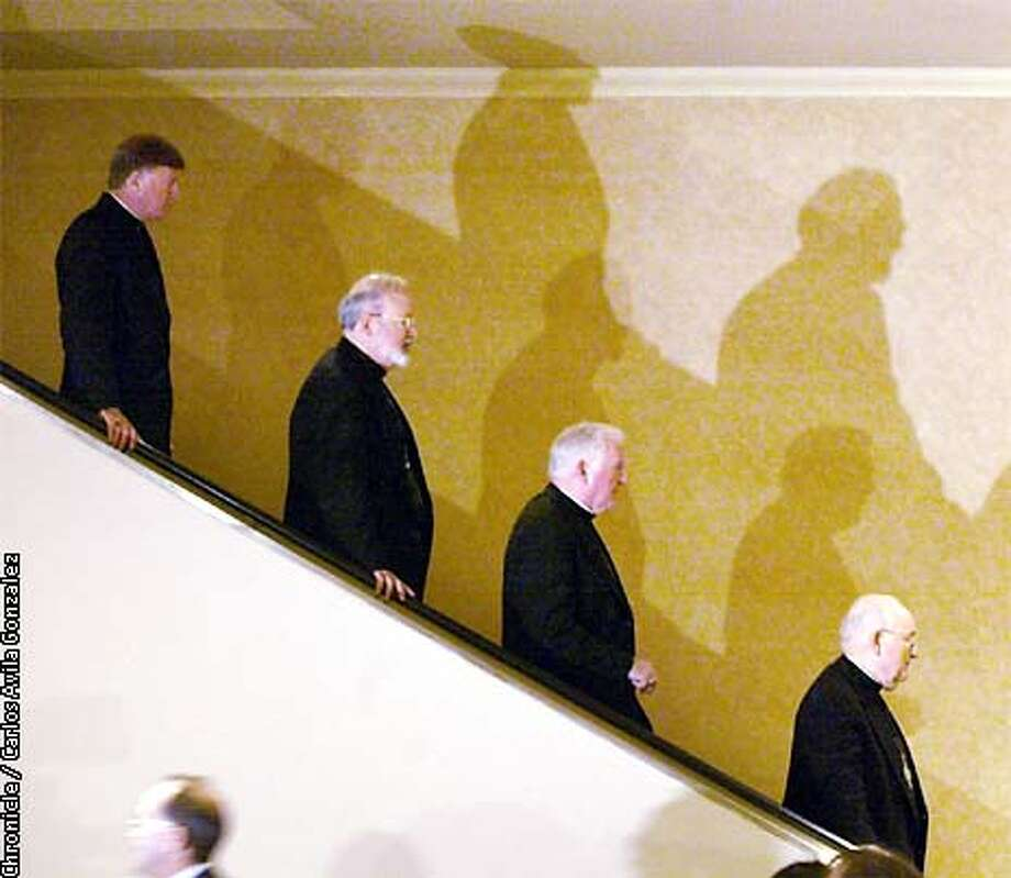 Catholics Bishops from all over the United States, leave the morning session of the Bishops' Conference in Dallas, Tx., on Thursday, June 14, 2002. The morning session included meetings and talks with survivors of clerical sexual abuse. (CARLOS AVILA GONZALEZ/SAN FRANCISCO CHRONICLE) Photo: CARLOS AVILA GONZALEZ