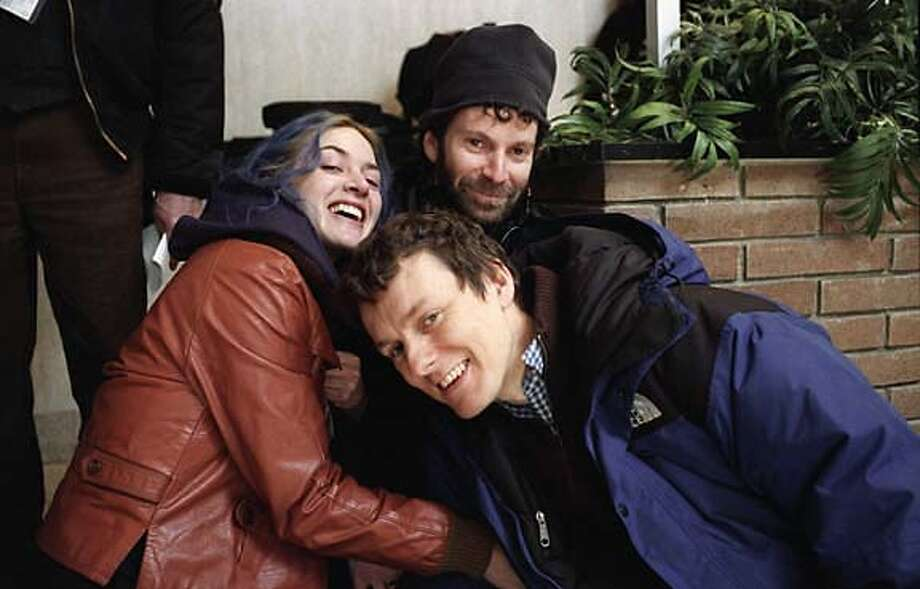 """""""Eternal Sunshine of the Spotless Mind"""" actress Kate Winslet, director Michel Gondry (foreground) and writer Charlie Kaufman."""