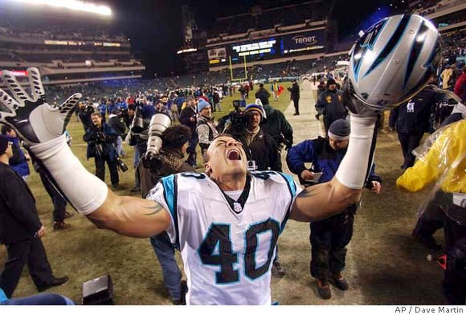 Carolina Panthers' Jarrod Cooper celebrates after defeating the Philadelphia Eagles 14-3 in the NFC Championship game in Philadelphia Sunday, Jan. 18, 2004. (AP Photo/Dave Martin) Photo: DAVE MARTIN