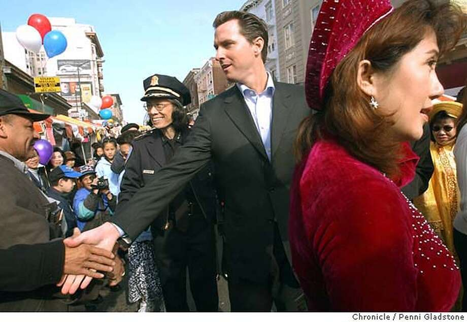 San Francisco Mayor, Gavin Newsom walks the street with newly-appointed Police Chief, Heather Fong, left, during the Tet Festival, in San Francisco, Ca., on Sunday, January 18, 2004. Photo By PENNI GLADSTONE / The San Francisco Chronicle Photo: PENNI GLADSTONE