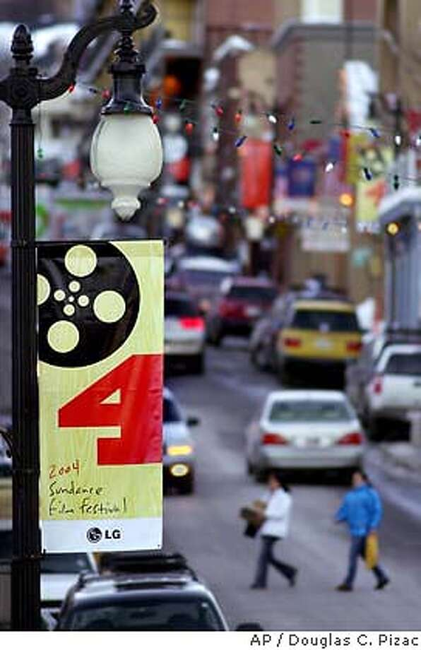 Festival banners decorate the Main Street sidewalks Wednesday, Jan. 14, 2004, the day before the Sundance Film Festival starts in Park City, Utah. The annual event starts Thursday. (AP Photo/Douglas C. Pizac) Photo: DOUGLAS C. PIZAC