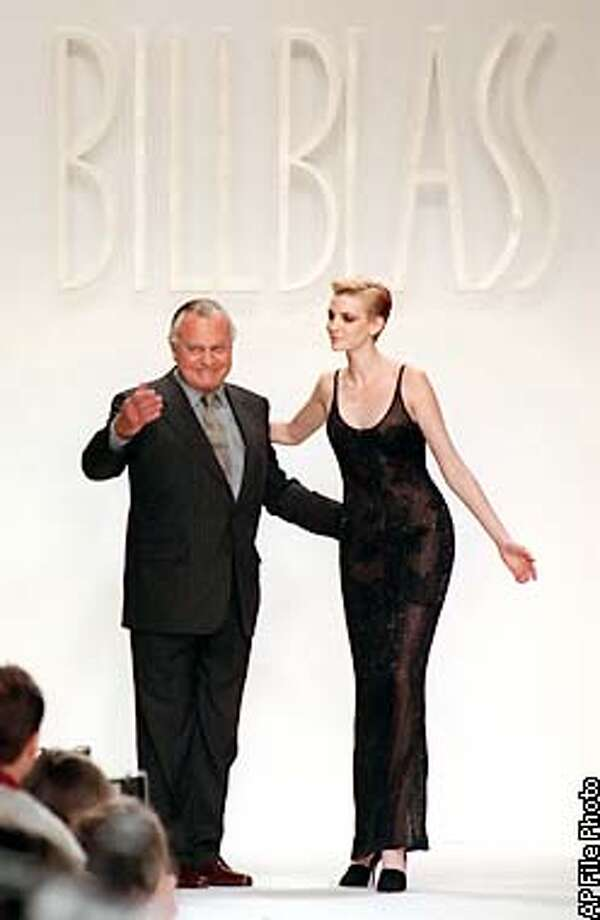 Designer Bill Blass acknowledges audience applause with model Nadja Auermann after the showing of his Fall 1996 collection in New York Monday April 1, 1996. Auermann models a black beaded slip dress with lace lining. (AP Photo/Richard Drew) Photo: RICHARD DREW