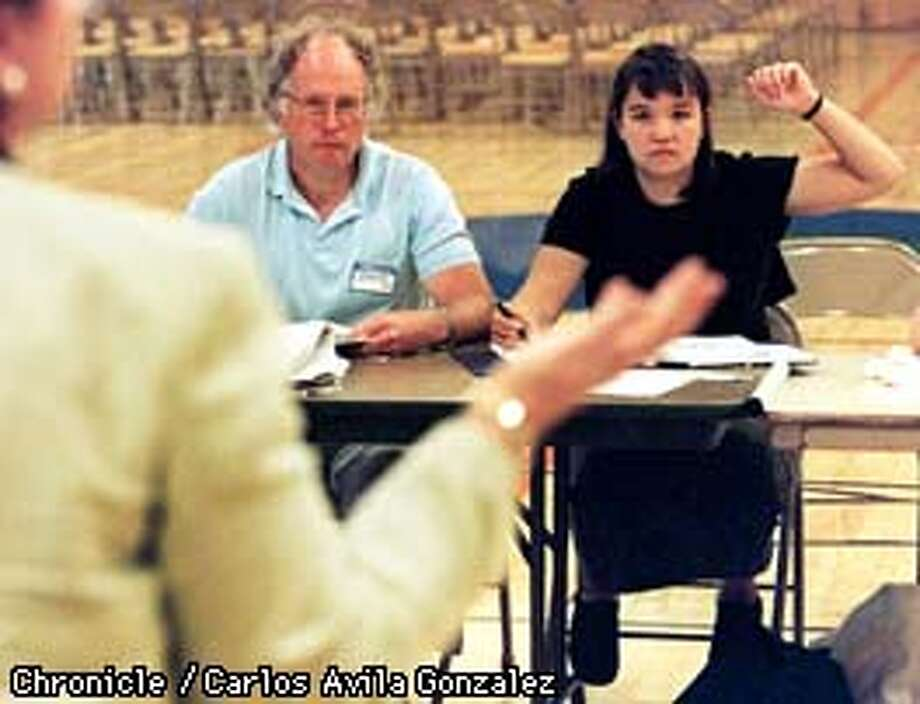 LAURIE WONG RAISES HER HAND IN RESPONSE TO A TEACHER'S QUESTION DURING A SEMINAR FOR TEACHERS AT JUAN CRESPI JUNIOR HIGH SCHOOL IN PINOLE ON THURSDAY, AUGUST 21, 1997. (CHRONICLE PHOTO BY CARLOS AVILA GONZALEZ) Photo: CARLOS AVILA GONZALEZ