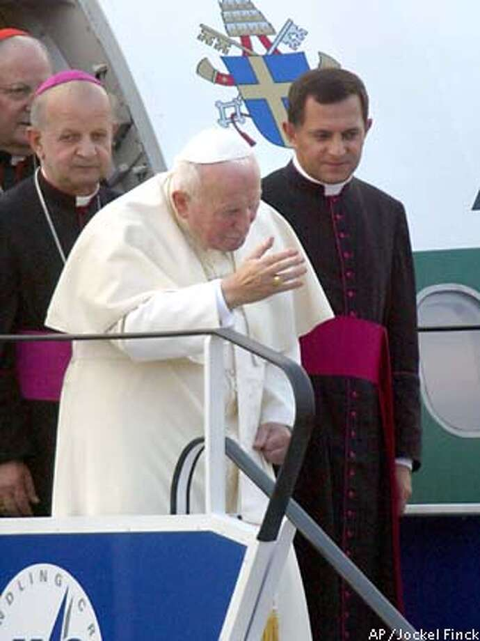 Pope John Paul II arrives at the Balice Airport near Krakow, Friday, Aug.16, 2002. Up to four million pilgrims are expected to greet the holy father during his Friday, Aug.16 to Monday, Aug.19 homecoming. (AP Photo/Jockel Finck) Photo: JOCKEL FINCK