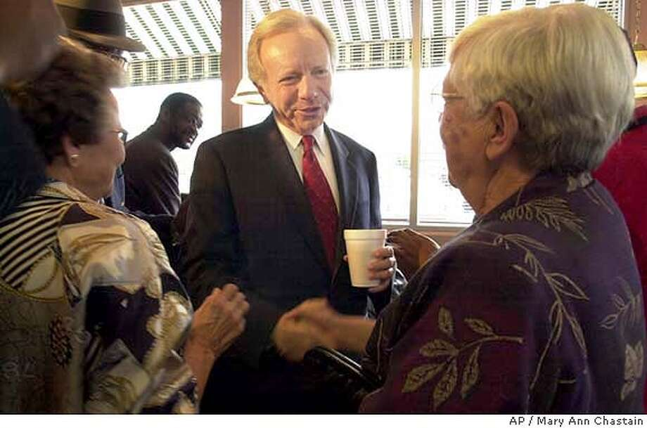 Democratic presidential hopeful, Sen. Joe Lieberman,D-Conn. shakes hands as he visits with voters at Workman's Restaurant Sunday Jan. 18, 2004, in Greenwood, S.C. Lieberman was making campaign stops in rural towns in South Carolina unveiling his anti-poverty plan. (AP Photo/Mary Ann Chastain) Photo: MARY ANN CHASTAIN