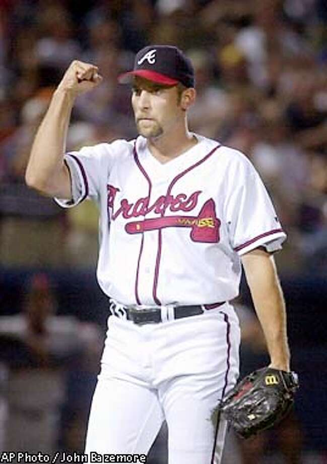 Atlanta Braves closer John Smoltz reacts after getting San Francisco Giants Rich Aurilia to ground into a double play to end the 8th inning in Atlanta, Wednesday, Aug. 14, 2002. The Braves won, 1-0, and Smoltz recorded his 42nd save of the season. (AP Photo/John Bazemore) Photo: JOHN BAZEMORE
