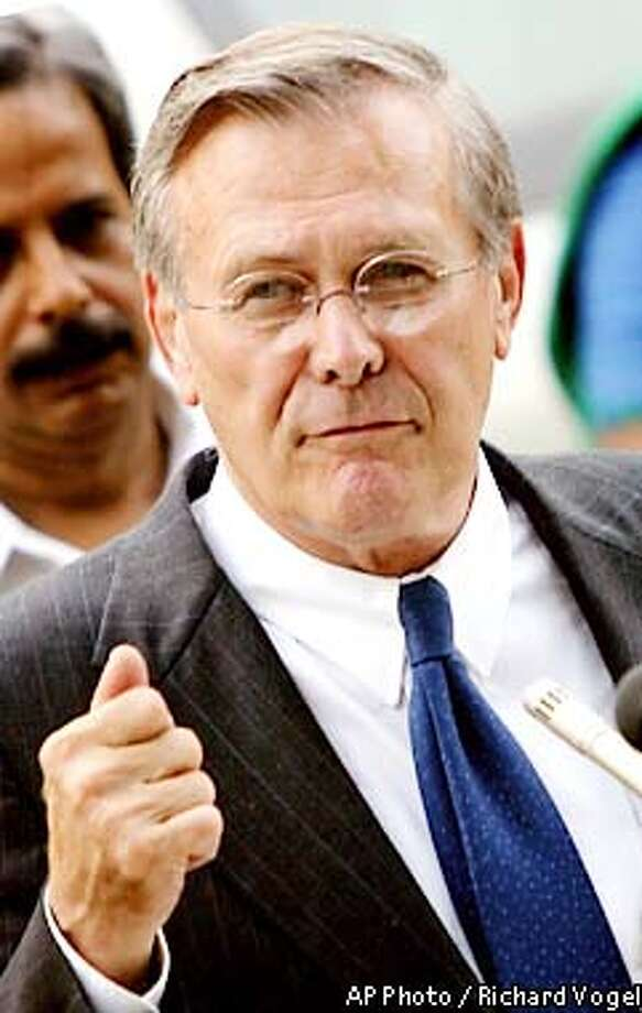 U.S. Defense Secretary Ronald H. Rumsfeld fields questions from the press after a meeting with Indian Prime Minister Atal Bihari Vajpayee in New Delhi, India, Wednesday, June 12, 2002. Rumsfeld is in India to try to help ease tension between India and Pakistan. After meeting with Vajpayee, Rumsfeld credited the Indian prime minister with taking important steps to lower tensions with Pakistan. (AP Photo/Richard Vogel) Photo: RICHARD VOGEL