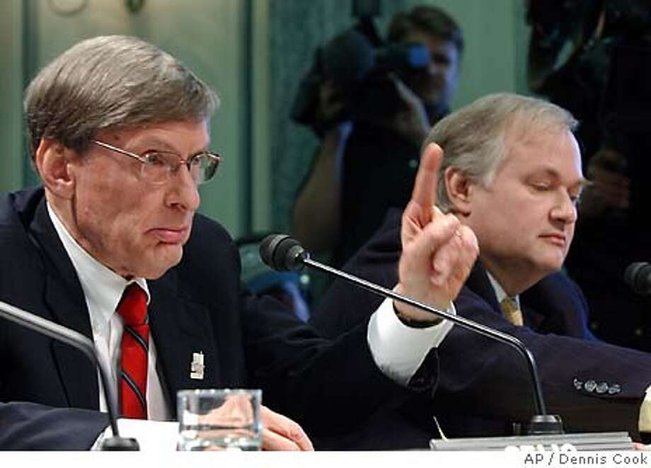 "Major Leage Baseball Commissioner Allan ""Bud"" Selig, left, testifies on professional sports drug testing policies before the Senate Commerce, Science and Transportation Committee on Capitol Hill Wednesday, March 10, 2004. At right is Donald Fehr, executive director of the Major League Baseball Players Association. (AP Photo/Dennis Cook) Photo: DENNIS COOK"