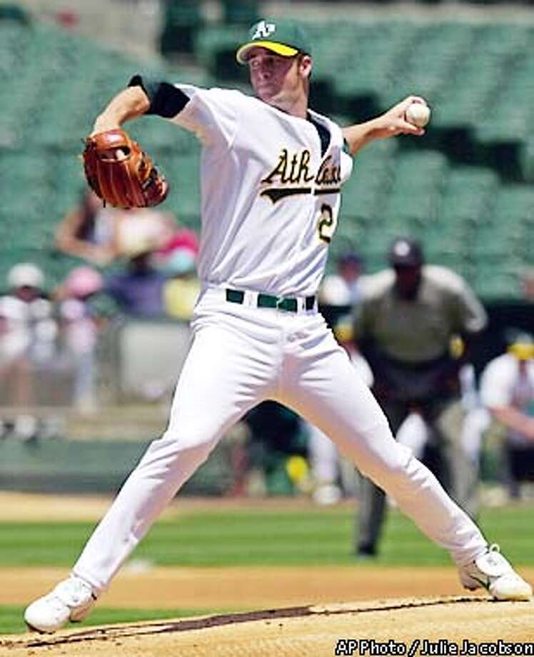 Oakland Athletics pitcher Mark Mulder works against the Milwaukee Brewers during the first inning Wednesday, June 12, 2002 in Oakland, Calif. Mulder gave up no runs before leaving the game with one out in the ninth inning. (AP Photo/Julie Jacobson) Photo: JULIE JACOBSON
