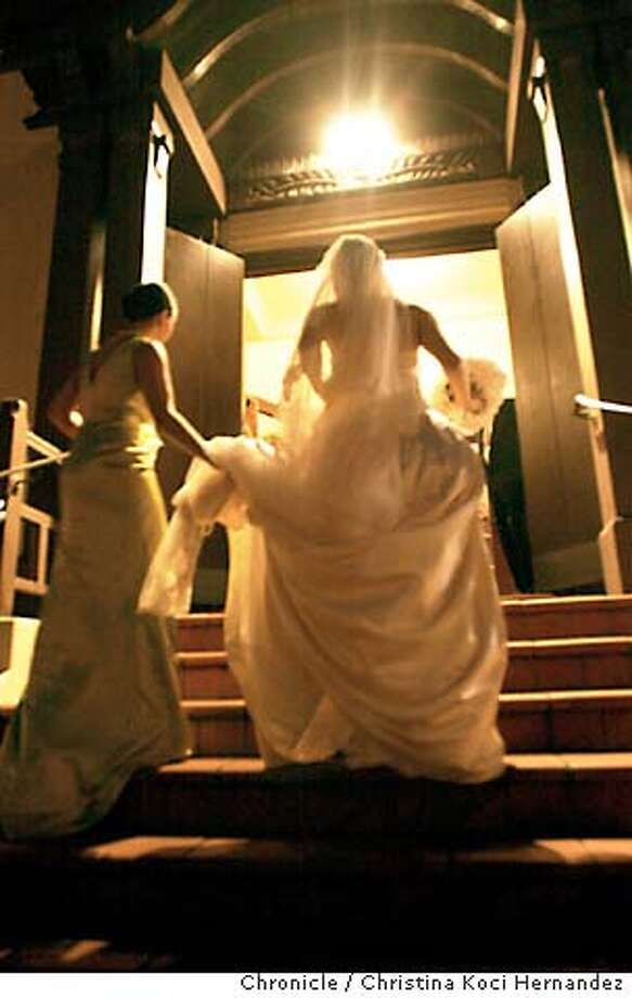 "commitments18_011004_kocihernandez  CHRISTINA KOCI HERNANDEZ/CHRONICLE The bride enters the church to be married. We cover the wedding of Cecilia de Quesada and Lawrence Wilkinson (""Wil"") Harris IV. She is the daughter of an interior designer and the stepdaughter of a prominent plastic surgeon, well-regarded in high society circles. He is a former banking exec who is starting an Argentinian restaurant here in town. Cecilia de Quesada enters St. Francis Xavier Church, above, on her wedding day. At left, the bride and groom, Lawrence Wilkinson Harris IV, who first met in 1991, took their vows before a gathering of 200. Photo: CHRISTINA KOCI HERNANDEZ"