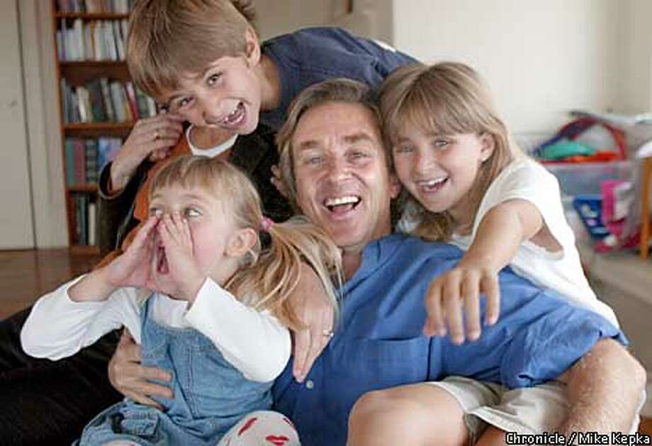 """James Steyer, author of """"The Other Parent: The inside story of the Media's Effect on Our Children"""" poses for the camera with his kids, Carli, 4, Kirk, 7, and Lili, 9. BY MIKE KEPKA/THE CHRONICLE Photo: MIKE KEPKA"""