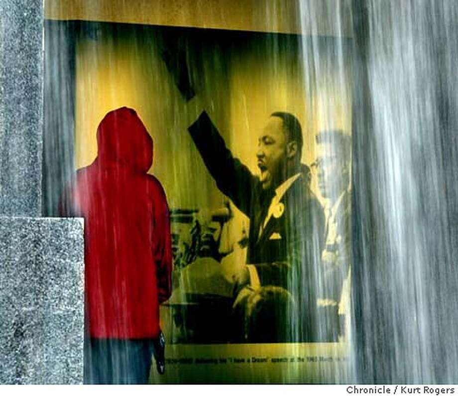 In observance of Martin Luther King Jr . Alexander Sanchez 9 years old from oakland stopped to look a the the photo of of him that is under the waterfall in the Yerba Buena Gardens . Event on 1/17/04 in San Francisco. KURT ROGERS / The Chronicle Photo: KURT ROGERS