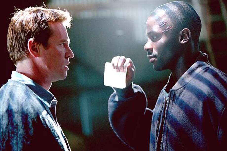 """SPARTAN12  VAL KILMER (left) and DEREK LUKE in Franchise Pictures' """"Spartan,"""" also starring William H. Macy, distributed by Warner Bros. Pictures."""