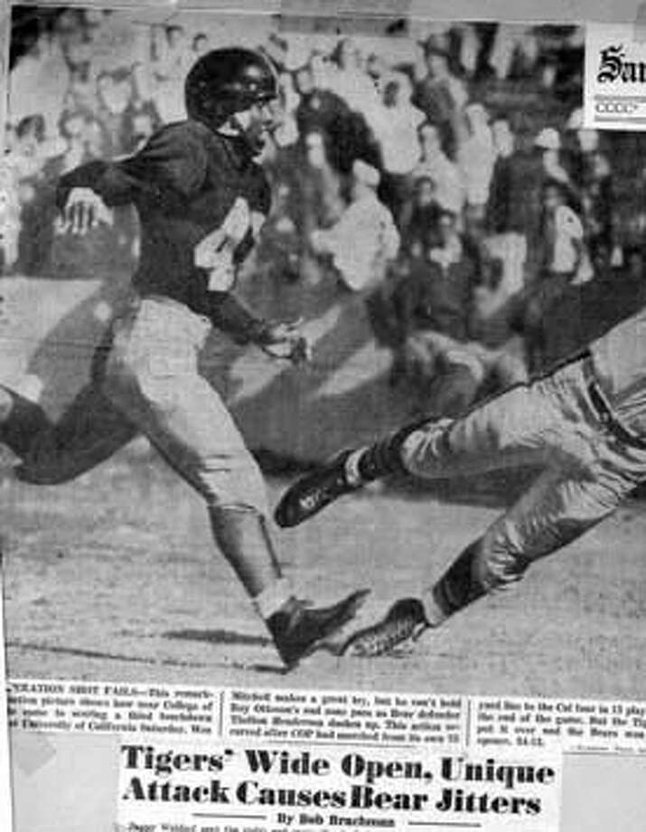 HENDERSON3/B/23SEP52/SAN FRANCISCO EXAMINER  CAL DEFENDER THELTON HENDERSON DASHES UP AS WES MITCHELL OF COLLEGE OF PACIFIC TRIES TO HOLD ONTO ROY OTTOSON'S END ZONE PASS. THE BEARS WON THE SEASON OPENER 34-13.