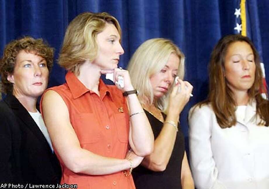 Family members of vicitms of the Sept. 11 terrorist attacks look on during a Washignton news conference Thursday, Aug. 15, 2002 where it was announced that legal action would be taken against Saudi officials and institutions, charging they financed Osama bin Laden's terrorist network. From left are, Ellen Saracini, whose husband Victor was the captain of United Airlines Flight 175; Tara Bane, whose husband died at the World Trade Center; Fiona Havlish, whose husband, Don, worked on the 101st floor of the south tower; and Sara Mulligan, wife of a New York firefighter. (AP Photo/Lawrence Jackson) Photo: LAWRENCE JACKSON