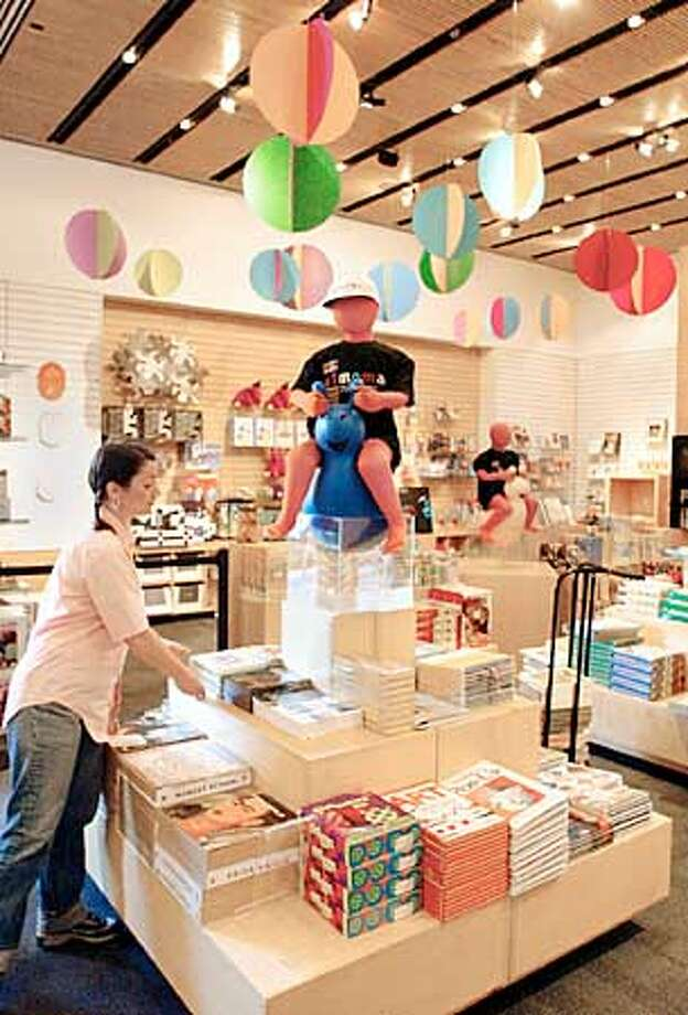 Museum of Modern Art, (MOMA), San Francisco  SFMOMA retail shop has been remodeled and expanded.  Camille Verboort 'cq.' arranges products in the childerns section of the museum book store  photo/John O'Hara Photo: John O'Hara