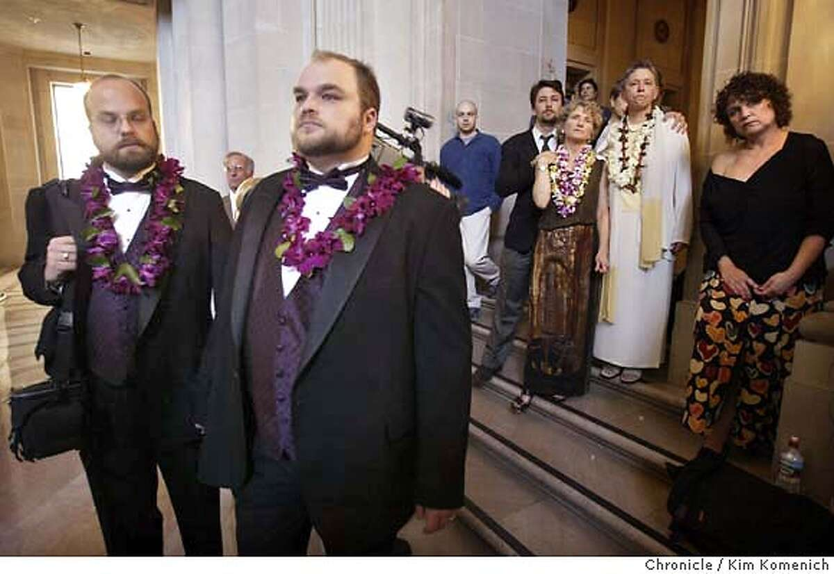 Stuart Sanders and his partner Ross Ladouceur (in tuxedos, at left (831) 338-0381) , of Boulder Creek, Ca., had a 3:30 pm appointment to be married, but the ruling came down at about 2:30pm putting an end to their wedding plans. At right center is Christopher Bradshaw, 15, who is standing with his parents Pali Cooper and Jeanne Rizzo of Tiburon. The couple came to S.F. City Hall to get married, but did not make it in time. They stand in the crowd listening to Mayor Newsom's press conference at San Francisco City Hall. Word spreads at San Francisco City Hall that the California State Supreme Court ordered an immediate halt to same sex marriages in San Francisco. Chronicle photo by Kim Komenich in San Francisco