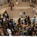 Same-sex marriage story continues. Mayors Office liason Joe Caruso, flanked by County Clerk Nancy Alfaro, announces that the weddings have been suspended.  Word spreads at San Francisco City Hall that a California State Supreme Court ordered an immediate halt to same sex marriage in the City.  Chronicle photo by Kim Komenich in San Francisco