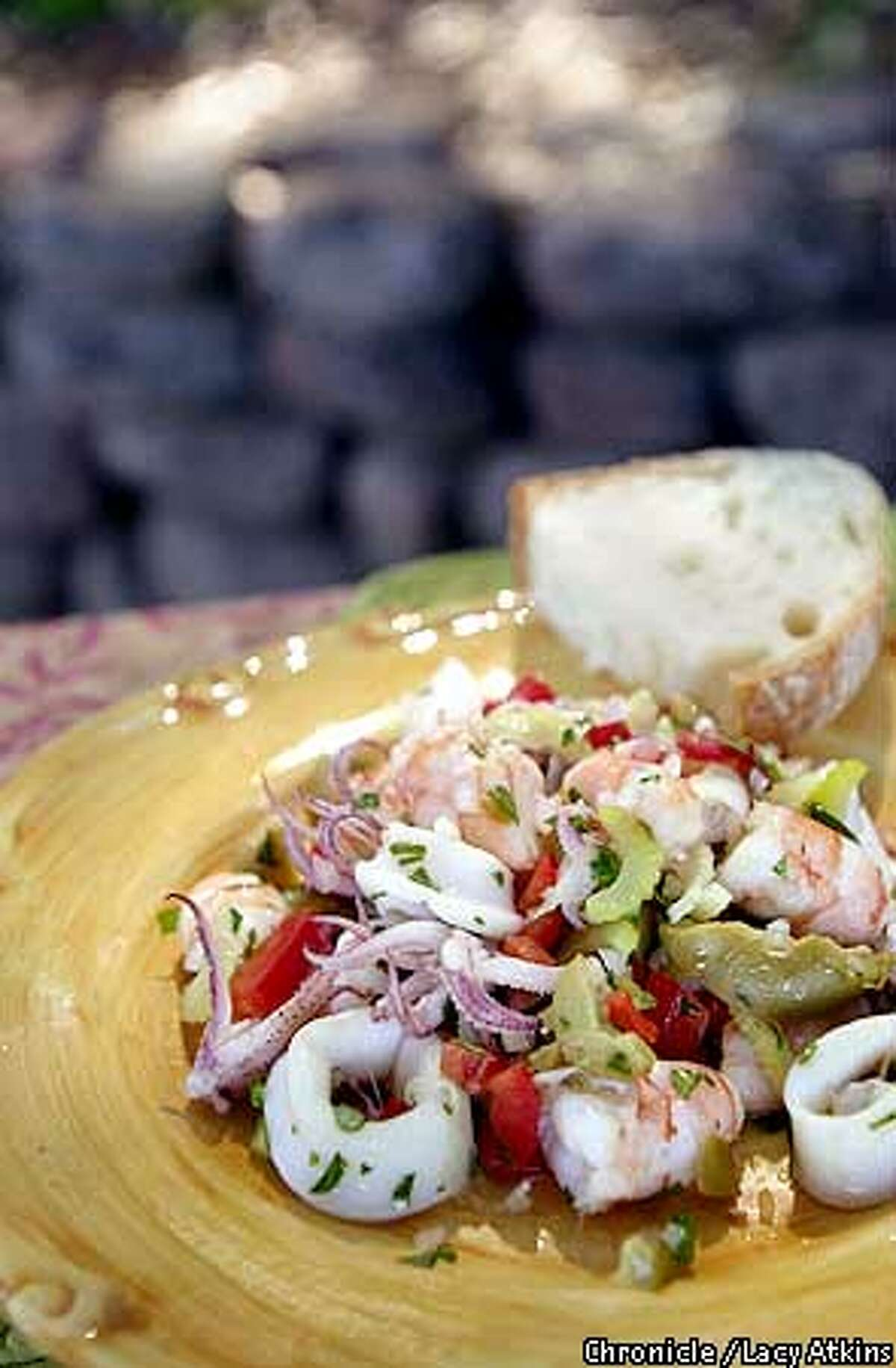 An Italian mixed seafood salad appetizer, often with shrimp and squid, make refreshing additions to any outdoor menu.