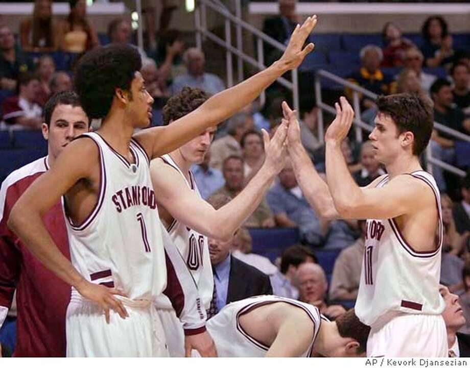 Stanford's Josh Childress, left, congratulates Chris Hernandez, right, after coming out of the game in the first round of the Pac-10 tournament Thursday, March 11, 2004, in Los Angeles. Childress scored a team high 17 points and Stanford won, 68-47. (AP Photo/Kevork Djansezian) Photo: KEVORK DJANSEZIAN